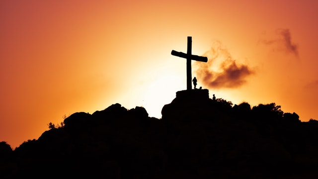 Cross on mountain at dusk