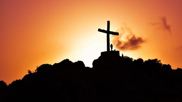 Cross on mountain at dusk